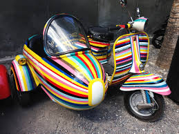 A Candy Striped Vintage Vespa With Matching Sidecar