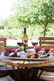 Fresh Fruit And Artisanal Cheeses Give This Outdoor Table Setting A Rustic Charm Wine