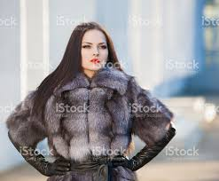 woman fur coat and black leather gloves stock photo 493941790 istock