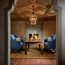 Tuscan Red Floor Dining Room Photo In Miami With Beige Walls A Standard Fireplace And