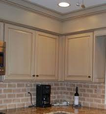 hide kitchen soffit with molding and crown molding closing in