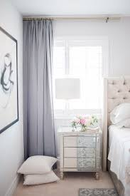 Feminine Bedroom With Violet Curtains A Creme Upholstered Headboard And Mirrored Vanity