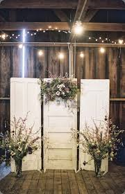 A Clever Way To Use Old Doors And Dried Flowers Create Rustic Backdrop For Photo Booth Or Even Behind Bridal Table Indian Wedding Decor