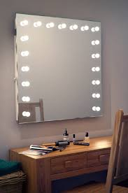 a vanity makeup mirror with light bulbs doherty house