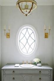Chandelier Over Bathroom Sink by Elegant Tuscan Dining Room With Wrought Iron Chandelier Over
