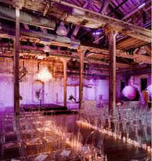 Rustic Elegance Wedding Ceremony Decor With Purple Lighting Clear Chairs Tea Light Lit Aisle