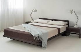 modern floating platform bed on black wooden bunk all white