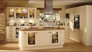 Great Cream Color Kitchen Island Features Cabinets And Glass Door Plus Built In Stoves Along With Cooker Hood Also