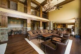 Leather Sectional Sofa Furniture For Rustic Living Room Ideas With Ottoman Coffee Table Design Also Wooden Flooring And Stone Wall HowieZine