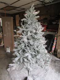 Flocking Powder For Christmas Trees by How To Flock A Christmas Tree White Spray Paint Wall