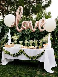 Picture Of Outdoor Dessert Table With Pink Balloons And Greenery