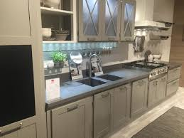 Gray Cabinets With Frosted Glass Door Solid Surface Sountertop Integral Sink Gas Range Vinyl Flooring White Vent Hood