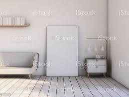moderne wohnzimmer weiße holzboden sofa mit leeren rahmen leinwand auf dem boden 3drendering stockfoto und mehr bilder aktenmappe