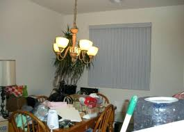 Off Center Chandelier Cluttered Dining Room Table Piled With Stuff Crooked Not Straight Light Home