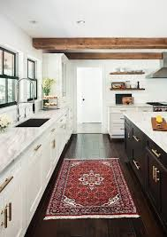 Two Tone Cabinets Brass Hardware Marble Countertops Black Trim Wood Floors Accents