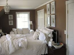 Brown And Blue Bedding by Brown Painted Bedroom Wall With Master Bed Using White Bedding Set