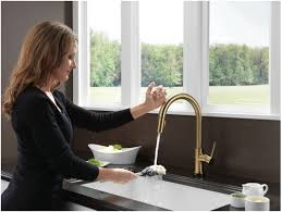 Delta Trinsic Faucet With Soap Dispenser by Faucet Com 9159t Ar Dst In Arctic Stainless By Delta