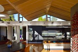 Black Kitchen Island Design At Awesome Mountain Range House In South Of New Zealand