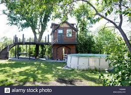 100 Tree Houses With Hot Tubs Fanciful Two Story Tree House With A Long Curved Stairway Beside A