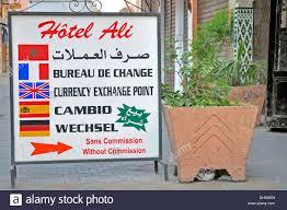 bureau de change sans commission sign currency exchange office in five languages marrakech stock