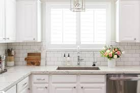 white granite kitchen countertops with white subway tile