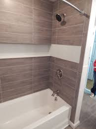 Home Ideas : Chic Bathroom Shower Tub Tile Scenic Custom Tub And ... Bathroom Good Looking Brown Tiled Bath Surround For Small Stunning Tub Tile Remodel Modern Pictures Bathtub Amazing Shower Ideas Design Designs Stunni The Part 1 How To Tile 60 Tub Surround Walls Preparation Where To And Subway Tile Design Remarkable Wall Floor Tiles Best Monumental Beveled Backsplash Navy Blue Argusmcom Paint Colors Frameless Doors Stall Replacing Of Jacuzzi Lowes To Her