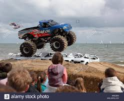 Spectators Look On As Bigfoot Monster Truck Leaps Over Cars Stacked ... Bigfoot Car Front Field Outline Icon Element Of Monster Trucks Show Traxxas 110 Rtr Truck Firestone Tra360841 Migrates West Leaving Hazelwood Without Landmark Metro Bigfoot 4x4 Inc Home Facebook 118 Remote Control Rc Cars Offroad Vehicles Review Big Squid And Boyer By Budhatrain Rccrawler Filebigfoot 17jpg Wikimedia Commons Truck Wikipedia Amazoncom Scale Readytorace Classic Blue Hobbyquarters
