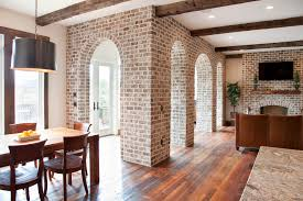 Impressive Fake Brick Wall Trend Charleston Traditional Living Room Image Ideas With Arches Arch Fireplace Drum