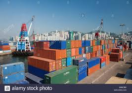 Large Stacks Of Shipping Containers On Dock In Hong Kong Harbour A Beautiful Clear Sunny