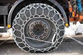 Truck Wheel With The Snow Chains Stock Photo, Picture And Royalty ...