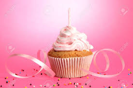 tasty birthday cupcake with candle on pink background Stock