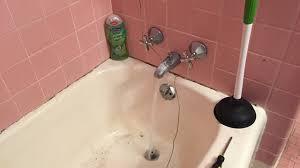 Unclogging A Bathtub Drain With Vinegar by How To Unclog A Bathtub Drain With Standing Water Using A Coat