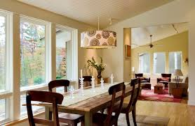 baseboard ceilings with funky light fixtures and rustic dining