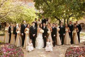 Bridesmaids In Gold And Groomsmen Tuxedos
