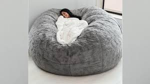 The LoveSac Pillow And Other Comfy Chairs To Try This Winter Top 10 Bean Bag Chairs Of 2019 Video Review Attractive Young Woman Lying On Red Square Shaped Beanbag Sofa Slab Red 3 Sizes Candy Chair Us 2242 41 Offlevmoon Medium Camouflage Beanbags Kids Bed For Sleeping Portable Folding Child Seat Sofa Zac Without The Fillerin Real Leather Modern Style Futon Couch Sleeper Lounge Sleep Dorm Hotel Beans Velvet Plain Collection Yogibo Family Fun Fniture 17 Best To Consider For Your Living