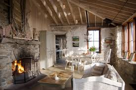 Country Concrete Floor Living Room Photo In Portland Maine With A Stone Fireplace