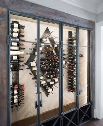 Contemporary Wine Room With Wood Herringbone Wall Vertical Racks