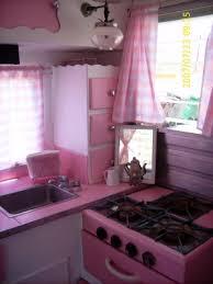 Vintage Camper With A Pink Kitchen