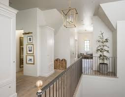 second floor landing with iron staircase railing and brass finials