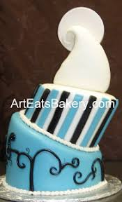 Two tier topsy turvy custom nightmare before christmas blue black and white fondant wedding cake