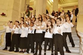 Who Sang Rockin Around The Christmas Tree by R F Kennedy Chorus Entertains At State House Tree Lighting