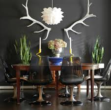 Example Of An Eclectic Dark Wood Floor Dining Room Design In Dallas With Black Walls