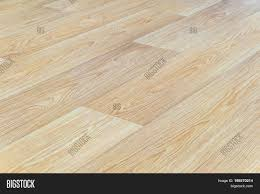 Linoleum Flooring With Embossed Light Wood Texture Close Up Horizontal Layout Perspective Limited