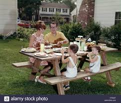 1960s FAMILY OF FOUR AT BACKYARD PICNIC TABLE Stock Photo, Royalty ... Urban Pnic 8 Small Backyard Entertaing Tips Plan A In Your Martha Stewart Free Images Nature Wine Flower Summer Food Cottage Design For New Cstruction Terrascapes Summer Fun Have Eat Out Outside Mixed Greens Blog Best 25 Pnic Ideas On Pinterest Diy Table Chris Lexis Bohemian Wedding Shelby Host Your Own Backyard Decor Tips And Recipes