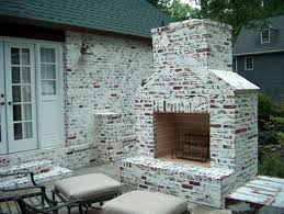 Outdoor Stone and Brick Custom Fireplace pany