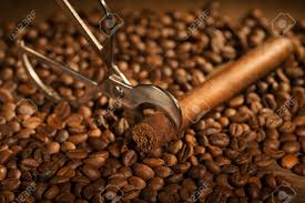 Selective Focus On The Cuban Cigar And Cutter Lying Heap Of Coffee Beans Stock