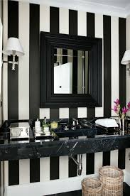 Source Luis Bustamante Chic Black And White Bathroom With Marble Floating Washstand Beveled Mirror Striped