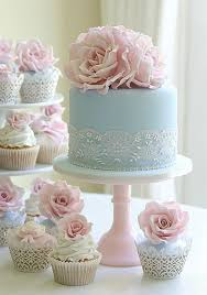 Elaborate Pastel Blue And Pink Wedding Cakes With Sugar Flower Details