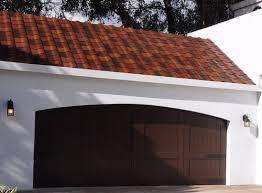 tesla unveils solar roof tile plans durability design news