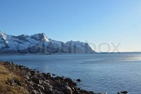 Fish Farm In The Ocean With Mighty Snow Covered Mountain Background Senja
